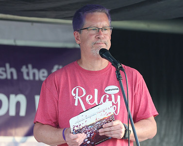 Cancer survivor Alan Wolf tells his story during Saturday's Relay For Life in Cranberry. Seb Foltz/Butler Eagle 06/26/21