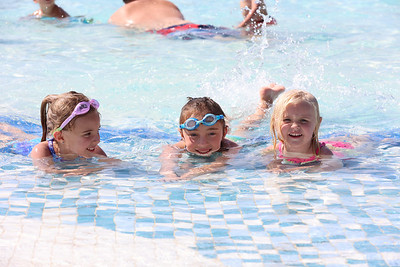 Charlotte, 5,(left), Cece, 7, and Catherine Nedzel, 2, relax in the shallow end of the Cranberry Community Waterpark Thursday. Seb Foltz/Butler Eagle 06/24/21