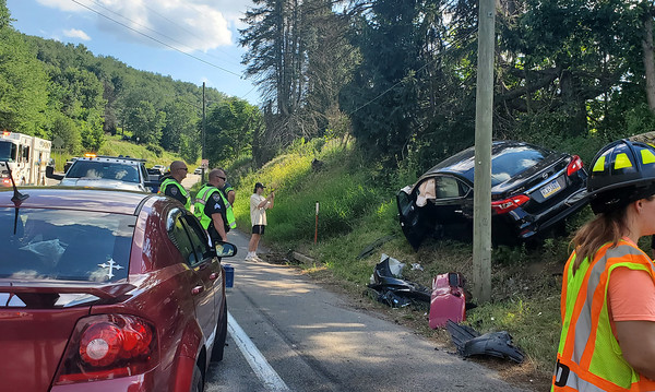 EDDIE TRIZZINO/BUTLER EAGLEPolice and fire fighters clean up the scene of a two-car collision at Pittsburgh Road at around 5 p.m. Monday afternoon.