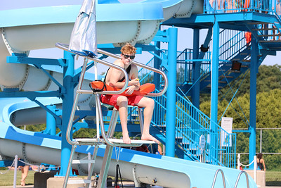 Colin Clark, 16, sits guard at the Cranberry Community Waterpark at North Boundary Park Thursday. Seb Foltz/Butler Eagle 06/24/21
