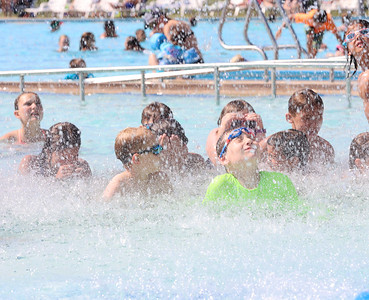 Children at Cranberry Community Waterpark get doused by the pools water bucket waterfall feature. Seb Foltz/Butler Eagle June 25 2021