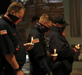 Adams Area Fire District captain Dough Mellinger (left), Taylor Goodlin and other Butler area firefighters participate in a candlelight vigil outside of Passavant Hospital in McCandles Saturday, with family and friends of Greg Vickinovac. As of Saturday night Vicknovac, a former Adams firefighter and current captain for Middlesex Township, was on a ventilator in the hospital's covid ward. Seb Foltz/Butler Eagle