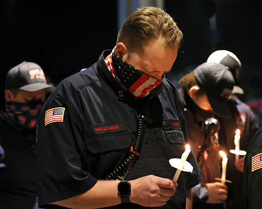 Adams Area Fire District captain Dough Mellinger and other Butler area firefighters participate in a candlelight vigil outside of Passavant Hospital in McCandles Saturday, with family and friends of Greg Vickinovac. As of Saturday night Vicknovac, a former Adams firefighter and current captain for Middlesex Township, was on a ventilator in the hospital's covid ward. Seb Foltz/Butler Eagle