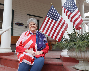 Zelienople Historical Society event organizer Adel Fatur sits on the stairs outside the goup's Passavant House. Seb Foltz/Butler Eagle 02/26/21  (4th of July Porch Decoration Story)