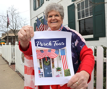 Zelienople Historical Society event organizer Adel Fatur stands outside the goup's Passavant House with an example of 4th of July porch decorations for their summer contest. Seb Foltz/Butler Eagle 02/26/21