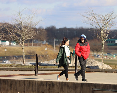 Slippery Rock University junior Chrystal Lord and sophomore Keegan Hitchings walk to the Smith Student Center Saturday. Seb Foltz/Butler Eagle 02/27/21
