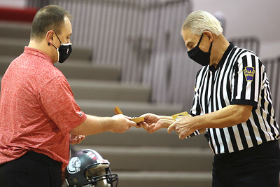 PIAA referee  Art Monteleone accepts a gift from Moniteau's athletic director John Stoughton during a surprise ceremony Saturday. Monteleone was honored for his 50 serving as a basketball and football official. The district threw a surprise ceremony prior to a girls basketball game. Seb Foltz/Butler Eagle 02/20/21