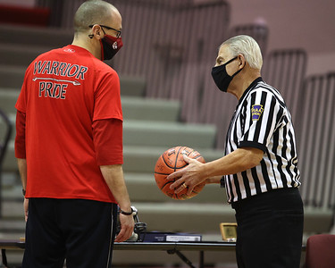 PIAA referee  Art Monteleone (right) recieves a signed basketball from Moniteau head boys basketball coach Mike Jewart. Monteleone was honored at Moniteau High School Saturday for his 50 serving as a basketball and football official. The district threw a surprise ceremony prior to a girls basketball game. Seb Foltz/Butler Eagle 02/20/21