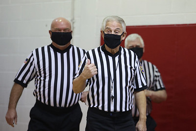 PIAA referee  Art Monteleone(center) reacts to a surprise ceremony prior to a Moniteau girls basketball game Satuday.  He was honored at Moniteau High School Saturday for his 50 serving as a basketball and football official. Seb Foltz/Butler Eagle 02/20/21