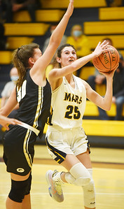 Mars junior Kaitlyn Pelaia goes up for a layup in the fourth period against Gateway's Becca Ryan Monday, March 1, 2021