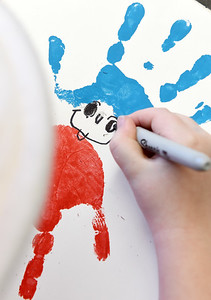 First-graders in Mr. Brian Herlihy's class used hand paintings to create red fish and blue fish in recognition of Dr. Seuss.  Harold Aughton/Butler Eagle.