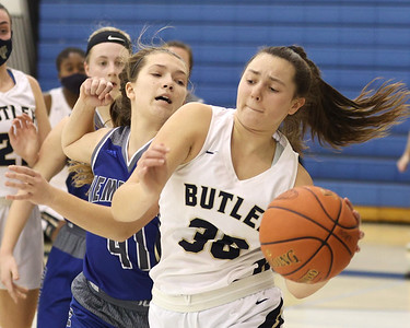 Butler's Makenna Maier drives to the hoop against Hempfied's Sarah Podkul in Butler's 48-36 home playoff win Wednesday. Seb Foltz/Butler Eagle 03/03/21