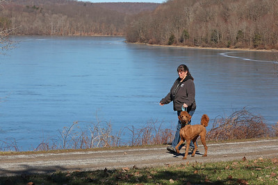 Sue Bartko walks her dog Scarlet along Moraine State Park's South Shore Tuesday. Seb Foltz/Butler Eagle 03/02/21
