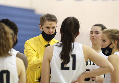 Butler girls basketball coach Mark Maier talks to the team during a timeout in Butler's 48-36 home playoff win Tuesday. Seb Foltz/Butler Eagle