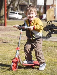 Cai Gould, 2, of Butler spent Wednesday afternoon playing with his mothe, Ally Gould and brothers, Luke, 4, and Elias, 9 months playing in Rotary Park. Harold Aughton/Butler Eagle.