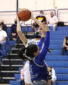 Butler's Alison Altman extends for a shot over Hempfield's Kelsi Terzolino in Butler's 48-36 home playoff win Wednesday. Seb Foltz/Butler Eagle 03/03/21