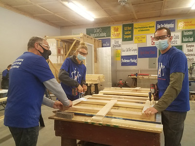 From left, Sleep in Heavenly Peace Co-President David Nock, his daughter, Kaylan Nock, and his son, Justin Knock, work on building a headboard during a recent build day for the Mars chapter of the charity that provides beds to children. SUBMITTED PHOTO