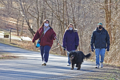 Ed Keiser(right) and Lynn Heasley (center) of Cranberry take advantage of sunny skies with a friend Tuesday, going for a walk at Moraine State Park's South Shore. Seb Foltz/Butler Eagle 03/02/21