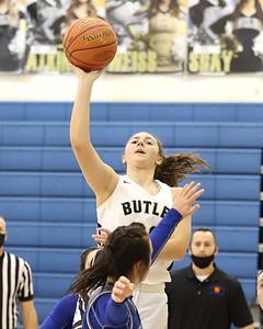 Butler's Makenna Maier extends for a shot against Hempfied in Butler's 48-36 home playoff win Wednesday. Seb Foltz/Butler Eagle 03/03/21