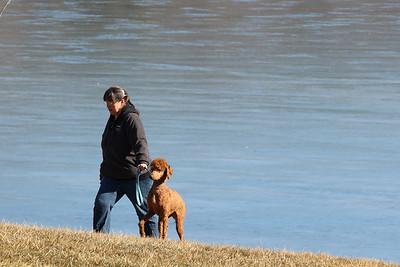 Sue Bartko walks her dog Scarlet along Moraine State Parks South Shore Tuesday. Seb Foltz/Butler Eagle 03/02/21
