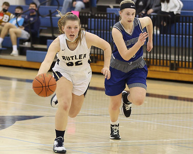 Butler's Maisy Gibson capitalizes with a fastbreak on a steal against Hempfield's Brooke McCoy in Butler's 48-36 home playoff win Wednesday. Seb Foltz/Butler Eagle 03/3/21