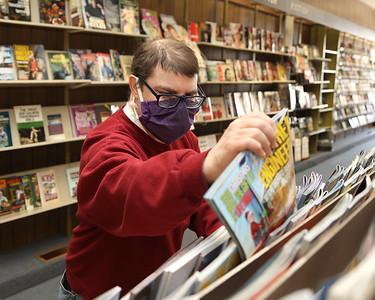 Erik Bell sorts magazines at the Book Nook on Main Street in Butler. Seb Foltz/Butler Eagle 03/03/21
