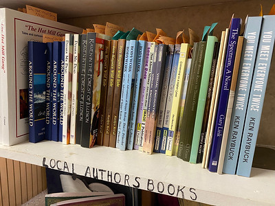 A shelf of local authors books at Readers' Paradise. Andy Andrews/Butler Eagle