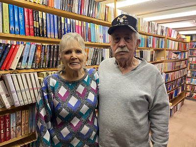 MaryAnn and Dennis Shook in their stocking room at Readers' Paradise in Oakland Township. Andy Andrews/Butler Eagle