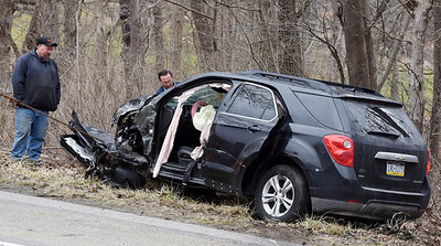 Tow truck drivers remove one of two vehicles that collided along Evans City Road sending two people to the hospital Thursday afternoon, March 4, 2021. Harold Aughton/Butler Eagle.