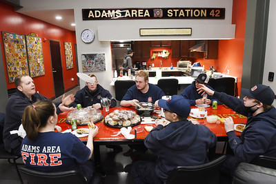 Adams Area Fire District volunteer firefighters sit down for a meal Tuesday, March 3, 2021. Harold Aughton/Butler Eagle
