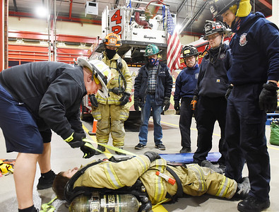 Assistant Chief Al Minjock demonstrates how to create a harness to help remove a downed firefighter from a fire Tuesday, March 2, 2021. Harold Aughton/Butler Eagle.