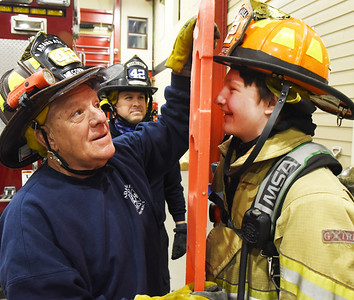 Adams Area Fire District, volunteer firefighter Gary McCormick helps strap junior firefighter Cody Safreed to a board during a rescue drill Tuesday, March 2, 2021. Harold Aughton/Butler Eagle Harold Aughton/Butler Eagle