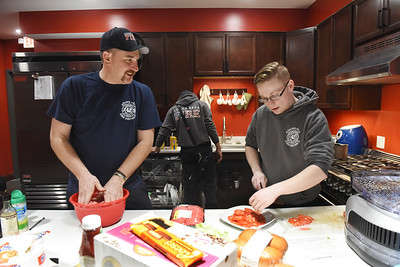 "Volunteer fireman, live-ins, Craig ""Arch"" Archer and Taylor ""Tito"" Goodlin prepare an evening meal for their fellow firefighters while Cody Safreed loads the dishwasher, Wednesday, March 3, 2021. Harold Aughton/Butler Eagle"