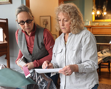 (Editors note: possible future story) Zelienople Historical Society volunteers Wendy Boffo (left) and Jan Maharg look at paint samples during renovations at the Passavant House. Historical Society members hope to reopen in April. Seb Foltz/Butler Eagle 02/26/21