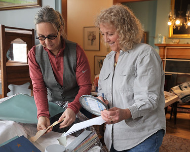 Zelienople Historical Society volunteers Wendy Boffo (left) and Jan Maharg look at paint samples during renovations at the Passavant House. Historical Society members hope to reopen in April. Seb Foltz/Butler Eagle 02/26/21