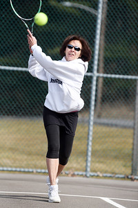 Former BC3 business dean, Rosemary Keasey, returns a serve during a tennis match between fellow retirees Gary Rick of Butler, Terry Anderson of Harmony, and Bob Lutz of Slippery Rock at Butler Memorial Park Tuesday morning, March 9, 2021. Harold Aughton/Butler Eagle.