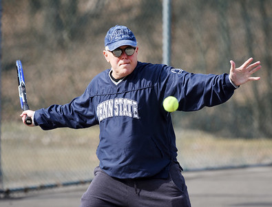 Gary Rick of Butler returns a serve during a tennis match between fellow retirees Bob Lutz of Slippery Rock, Terry Anderson of Harmony, and Rosemary Keasey of Butler at Memorial Park Tuesday morning, March 9, 2021. Harold Aughton/Butler Eagle.