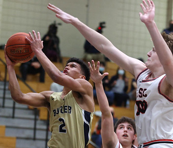 Butler's Devin Carney goes up for a layup against Upper St. Clair's Porter Rauch in Tuesday night's WPIAL semi final. Butler lost on the road 70-62. Seb Foltz/Butler Eagle 03/09/21