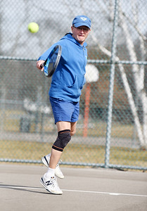 Bob Lutz of Slippery Rock returns a serve during a tennis match between fellow retirees Gary Rick of Butler, Terry Anderson of Harmony, and Rosemary Keasey of Butler at Memorial Park Tuesday morning, March 9, 2021. Harold Aughton/Butler Eagle.