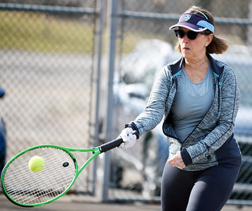 Terry Anderson of Harmony returns a serve during a tennis match between fellow retirees Gary Rick of Butler, Rosemary Keasey of Butler, and Bob Lutz of Slippery Rock at Butler Memorial Park Tuesday morning, March 9, 2021.  Harold Aughton/Butler Eagle.