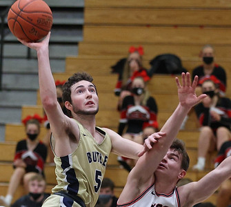 Butler's Mattix Clement extends for a shot against Upper St. Clair's Ethan Dahlem in Tuesday night's WPIAL semi final. Butler lost on the road 70-62. Seb Foltz/Butler Eagle 03/09/21