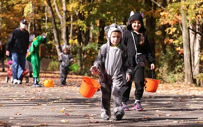 Oliver Clukey, 4, (front) and his sister Adelyn lead the family at Saturday's Butler Parks and Recreation Monster Walk at Alemeda Park. Seb Foltz/Butler Eagle 10/17/20