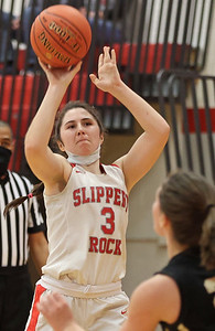 Slippery Rock's Maryann Ackerman shoots from 3-point range against Grove City in the Rockets home playoff win Tuesday. Seb Foltz/Butler Eagle 03/10/21
