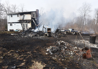 Fire companies from Prospect, Harmony, Evans City, Callery Butler Twp. and Connoquenessing responded to the fire in Connoquennessing Twp., Wednesday afternoon, March 10, 2021.  Harold Aughton/Butler Eagle.