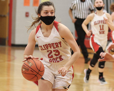 Slippery Rock's Anna Kadlubek drives down the court against Grove City in the Rockets home playoff win Tuesday. Seb Foltz/Butler Eagle 03/10/21