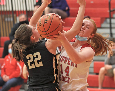 Slippery Rock's Hallie Raabe fights for a rebound against Grove City's Emma Santom in the Rockets home playoff win Tuesday. Seb Foltz/Butler Eagle 03/10/21