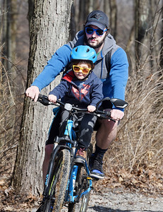 Eric Grenci of Butler took his four-year-old son, Nico to Alameda Park to ride the trails Wednesday morning, March 10, 2021.  Harold Aughton/Butler Eagle