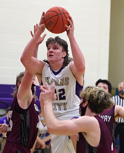 Karn City's Nathan Waltman goes up for his 1000th career point in Thursday's home playoff win against Ridgway. Seb Foltz/Butler Eagle 03/11/21