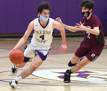 Karns City's Chase Beighley drives down the court against Ridgway's Jack Benninger in the Gremlin's home playoff win Thursday. Seb Foltz/Butler Eagle 03/11/21