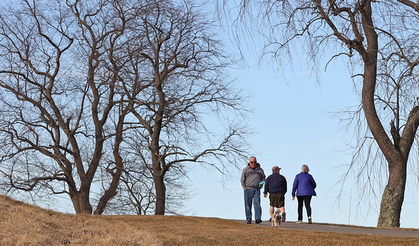 Walkers take advantage of blue skies and milder temperatures at North Boundary Park in Cranberry Friday. Seb Foltz/Butler Eagle 03/12/21